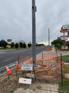 Construction of the traffic signal at Aguilar and Braker